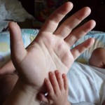 Even compared to my then-newborn's, my hand doesn't look that big.