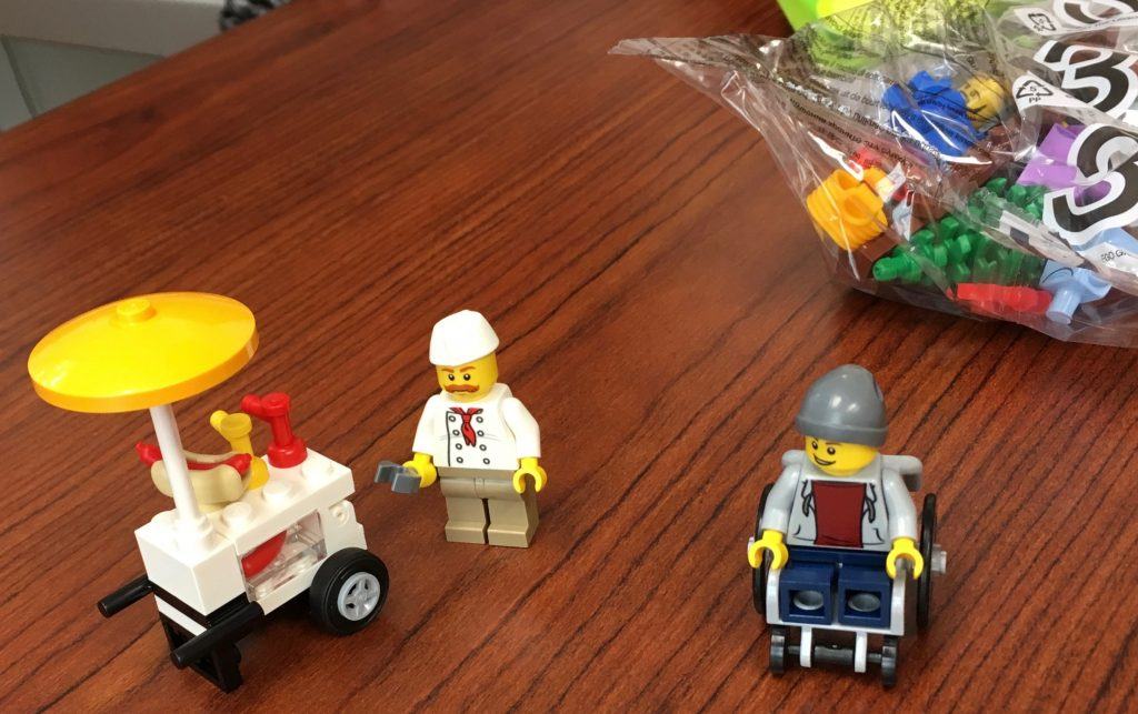 Wheelchair and mustachioed minifigs